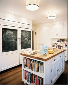 I would love to have a side of the kitchen cabinets with a built in bookcase for cookbooks!