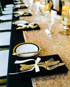 We love this color combination of black linen and a gold, sparkling table runner – sophisticated and chic! Photo by @abritandablonde   Event Planning by @bluelavenderevents   Linens by @linen_closet