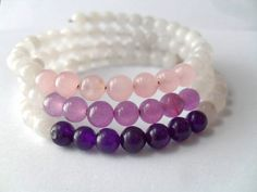 Unique designer gemstone bracelet, made with white jade, rose quartz, and amethyst beads on memory wire which coils around your wrist comfortably.