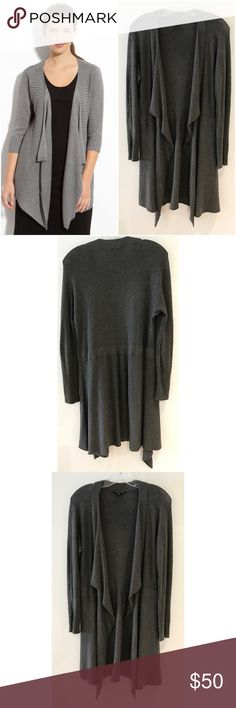 "Eileen Fisher gray Cascading Open Cardigan Sweater Still in good pre-loved dark charcoal grayopen cascading Cardigan from Eileen Fisher in size small. No major flaws. Some minor pilings on the sleeves area. It nothing noticeable when worn. Measure about 33"" length, 17"" pit to pit, 26"" Sleeves. Might fit medium too since the Cardigan have some stretch to it. ❌Model pic is so for visual aid and is similar item, mine is the last five pics above in DARK GRAY❌No modeling or trades. Open to…"