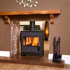 The Portway 2 Double-Sided Multi-fuel Stove. Experience the warmth and beauty of your Portway stove in two separate but adjacent rooms Wood Burner Fireplace, Open Fireplace, Fireplace Inserts, Double Sided Log Burner, Double Sided Fireplace, Contemporary Wood Burning Stoves, Stoves For Sale, Cottages For You, New Homes