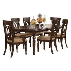 """The rich finish and elegant details of the """"Leighton"""" dining room collection features a sophisticated traditional style that is sure to enhance the beauty and style of any dining room decor. This decorative collection is bathed in a dark brown finish that flows beautifully over the ornate pilasters and framed details giving a subtle elegance that creates the perfect atmosphere for any dining experience."""