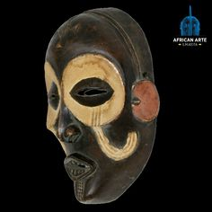 Tchokwe Chokwe Mask – Zambia This beautiful ihongo chokwe mask symbolizes wealth and power, with unusual scarification patterns on the eyeline and cheeks. The mask originates from the Chokwe people of Angola. The wearer is said to have judiciary powers. The cross on the forehead, known as cingelyengelye, is an early Portuguese influence. #Chokwe #zambia #africanart #utilitarian #artdeco #decoration #tribal #art #collection #decor #artifacts #culture #collectors #museum #gallery #luxury…