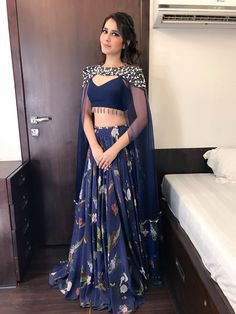 Product Name:- * 134 BLUE QUEEN INDO* Lehenga fabric:-Taffeta Silk(semi-stitch) Lehenga Colour:-Navy blue Lehenga Work:-heavy print… Lehnga Dress, Lehenga Blouse, Lehenga Choli, Floral Lehenga, Indowestern Lehenga, Jacket Lehenga, Bridal Lehenga, Lehenga Designs, Stylish Dresses