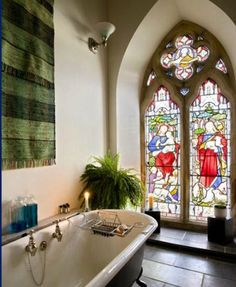 it is my dream to live in an old church. those windows! that TUB! superb.