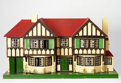 County house by British company Tri-Ang. Tri-ang sold a large range of dolls' houses, all of which reflected popular taste in domestic architecture and interiors, including cottages. Doll Museum, V & A Museum, Dolls House Shop, Toys Shop, Museum Of Childhood, Childhood Toys, Modern Dollhouse, Train Layouts, Victoria And Albert Museum