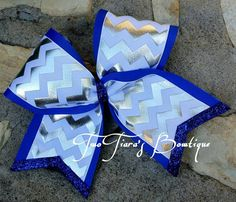 Royal blue white and silver foil chevron cheer bow! Great for cheer and softball! Teams, squads, state, competition, softball, pro shops! Team bows by Two Tiara's Bowtique on Etsy or Facebook as TwoTiaras Bowtique for more options and recent updates! Check out this item in my Etsy shop https://www.etsy.com/listing/216863079/blue-silver-white-chevron-cheer-bow-team