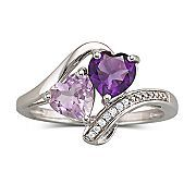 Purple heart ring. The shape is a little impractical, IMO, but I love the concept, especially the two differently-hued purple hearts.