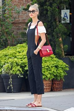 Model figure: Elsa Hosk looked casual chic in a pair of navy blue overalls and an off the ...