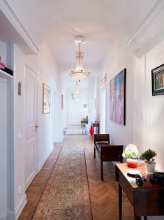 should I ever have a hallways this long, now I know what to do with it. simple & warm.