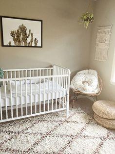 Boho gender neutral cactus theme nursery Moroccan rug IKEA stools faux fur dockatot