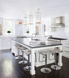 Gorgeous LEM Piston Stools in white at the kitchen island
