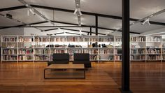 A graphic design firm takes on a large, light-filled floor plate and takes care of the things that matter most. Modular Shelving, Modular Storage, Adjustable Shelving, Stairwell Wall, Filing System, Metal Shelves, Office Storage, Floor Space, Design Firms