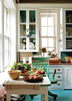 This kitchen reminds me of my grandmothers. Love the color, breezy open feeling and the idea that something wonderful is cooking or baking fresh from the garden and orchard.