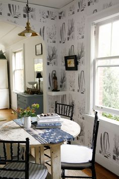 Designer Brian Paquette's Seattle dining room. He created his own wallpaper, using xeroxed seaweed studies | @natmarchbanks
