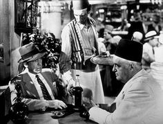 Casablanca photo from the film featuring Humphrey Bogart as Rick Blain as Sydney Greenstreet as Signor Ferrari in Ferrari's bar The Blue Parrot where Rick discusses selling his café to Ferrari before leaving Casablanca. Casablanca Movie, Casablanca 1942, Classic Movie Posters, Classic Movies, Great Films, Good Movies, Classic Hollywood, Old Hollywood, Bogie And Bacall
