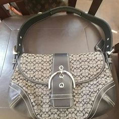 Vintage coach small c bag This little bag holds a lot very cute when you need a smaller bag to use very good condition no rips tears interior perfect condition additional pics in closet please note in pic 2 stain on exterior back Coach Bags Hobos