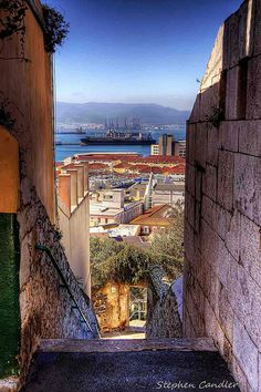 View of the docks down a steep street in Gibraltar.