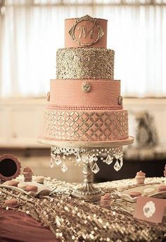 For a glamorous pink wedding - a pink cake with gold accentshttp://www.modwedding.com/galleries/wedding-cakes-desserts and bling by Diva of Cake ~