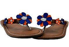 The Orange & Blue Flower Sandal features a light brown leather w/ a Gator head logo in the middle of the flower; a plated sterling silver gator charm.    Small = 6/7  Medium = 8/9  Large = 10/11