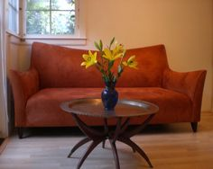 Comfortable burnt-orange sofa
