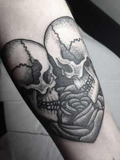 Skull tattoo. @Lauren Bromley or this one, and a bow on one of the skulls?. I like. :)