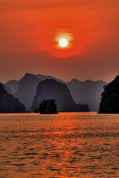 Halong Bay (Vietnam): Sunset (red dream colors) --- Ha Long Bay is a UNESCO World Heritage site located in Quảng Ninh province, Vietnam. The bay features thousands of limestone karsts and isles in various sizes and shapes.