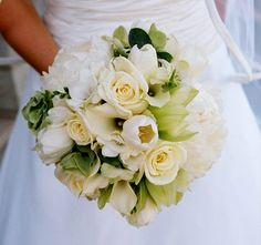 Bridal bouquet of White roses, white tulips, white peonies, white callas, green cymbidium orchids