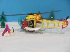 It took a while but I'm excited to share my entry for the expand the Winter Village contest! The story: A couple years ago this quiet mountain community b. Lego Helicopter, Lego Plane, Lego 4, Cool Lego, Lego Winter Village, Lego Fire, Lego Christmas, Lego Craft, Lego Models