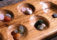 Mancala! I didn't know how to play just moved the stones around.