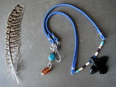 Raven Flies an Eclipse: Obsidian Native Fetish, Leather, Shell, Lapis Lazuli, Turquoise, Amber, Sterling silver, Crow, Necklace.