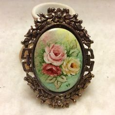 A personal favorite from my Etsy shop https://www.etsy.com/listing/292753321/vintage-hand-painted-porcelain-brooch