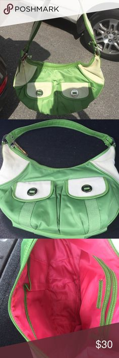 Green purse Green Nylon purse by Tommy Hilfiger.. Worn a couple of times. Has silver buckles. Tommy Hilfiger Bags Hobos