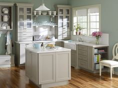 Like this Corian Sea Salt countertop with the grey cabinets with frosted glass tops.