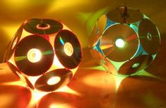 Lampshades From Old Cd's is part of Recycled crafts Lamp - Dodecahedron CD light (Barcelona by Bernat Capellades Exhibited at La Braderie du l'Art, Lille 1998 & International Festival of … Diy With Cds, Crafts With Cds, Recycled Cd Crafts, Old Cd Crafts, Recycled Lamp, Diy Crafts, Music Crafts, Cd Diy, Cd Recycling