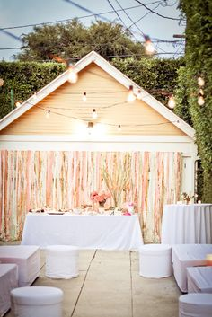 Backyard driveway and garage converted into a lounge space -diy w/.long wooden dowels from any hardware store, a hot glue gun, good scissors, a combo of inexpensive and fancy crepe paper