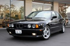 1991 BMW M5. I don't know if I prefer this or an equivalent 540i/6spd.