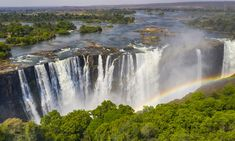 These famous falls are located in southern Africa at the border of Zambia and Zimbabwe. Victoria Falls are considered the largest (not tallest or widest) in Parc National, National Parks, Capital Of Ethiopia, Chutes Victoria, Largest Waterfall, Les Cascades, Victoria Falls, African Countries, Beaches In The World