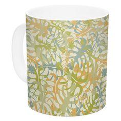 East Urban Home Warm Tropical Leaves by Julia Grifol 11 oz. Ceramic Coffee Mug