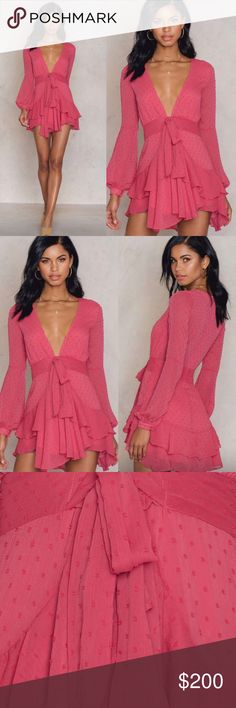 For Love & Lemons Dress Beautiful Tarta dress by For Love & Lemons in a color flamingo. Pretty pink dress with an orange undertone and a deep v cleavage. This dress it's made from a lightweight flowy fabric with ruffles giving it a very feminine look and a flattering cut. Brand new with tags! For Love and Lemons Dresses Mini