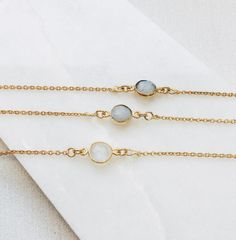 Gold necklace with cream stone and grey stone necklace! Love and protect your jewelry armoire #goldnecklace #womensjewelry