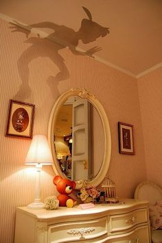 Peter Pan's shadow on children's wall- too cool of an idea! It isn't a painting of Peter Pan. It is a cut out that sets on top of the lamp shade & reflects onto the wall. Try with different shape
