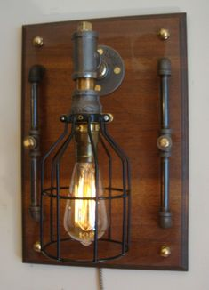 https://www.ebay.com/itm/Steampunk-Industrial-Age-Wall-Sconce-Lamp-Edison-Bulbs-Cage-Brass-Dimmer-/372171691544?hash=item56a7295618