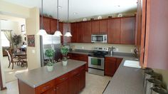 Amazing Kitchen with Stainless Steel Appliances, Cherry Cabinets and Center Island.