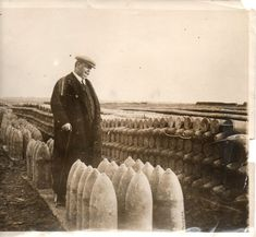 """This photo (dated 15 April 1916 by the news photo service of Underwood and Underwood) shows a French senator--H. Charles Humbert--viewing """"a field literally covered with shells"""",  the photo really only giving some glimpse of the extent of the palleted shells, which fade into the distance behind M. Humbert and extend deeply into the field in front of him."""