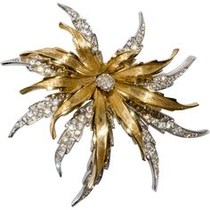 Boucher brooch featuring layered construction with the top being gold plated and the bottom rhodium plated. The rhodium plated bottom layer is pave'