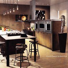 Sleek kitchen cabinets by Wood Mode.