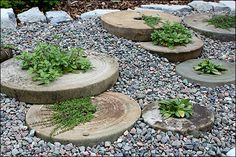 Millstones set in pea gravel