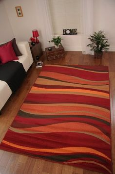 LOVE THIS RUG! This warmly coloured wave design rug is designed in shades  of red · Burnt Orange ...