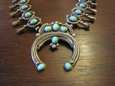 Rose Haley Long, a Navajo, Sterling Squash Blossom Necklace with Gorgeous Turquoise by HeartoftheSouthwest on Etsy